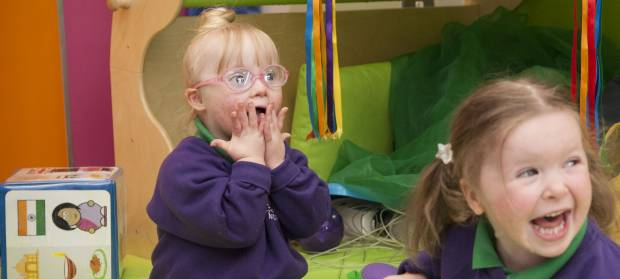 Daisy and Lucy sat together playing at Mencap Centre
