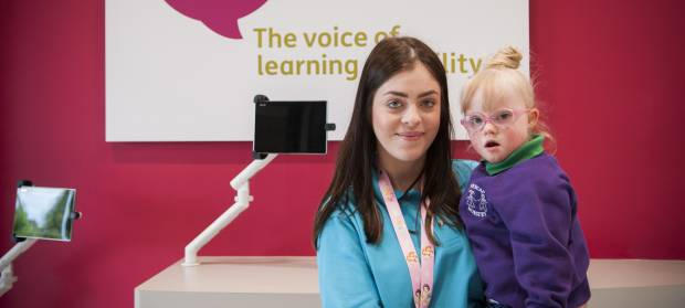 Woman at Mencap Children's Centre in Belfast holding young girl